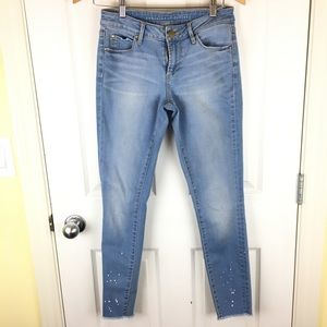 Light wash jeans with raw hem